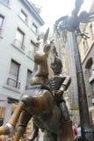 骑兵战士古铜色图在马 免版税库存照片