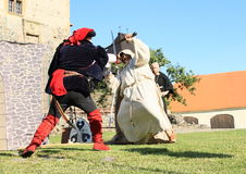 骑士-贵族和修士战斗 图库摄影
