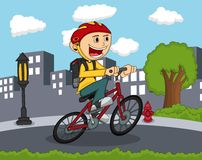 骑有城市背景动画片的小男孩一辆自行车 免版税库存照片