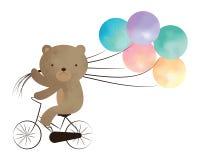 骑有气球的玩具熊一辆自行车 免版税图库摄影
