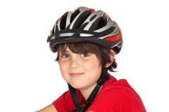 骑自行车儿童滑稽的盔甲 图库摄影