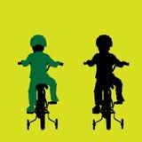骑自行车儿童骑马 库存照片