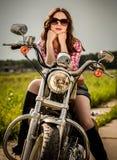 骑自行车的人女孩坐摩托车 库存图片
