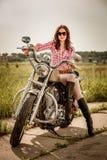骑自行车的人女孩坐摩托车 免版税库存照片