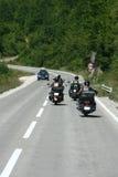 骑自行车的人摩托车砍刀乘驾 免版税图库摄影