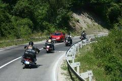骑自行车的人摩托车砍刀乘驾 库存照片