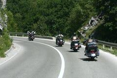 骑自行车的人摩托车砍刀乘驾 免版税库存图片