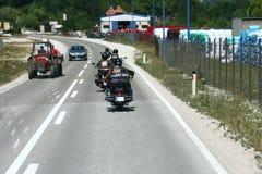 骑自行车的人摩托车砍刀乘驾 图库摄影