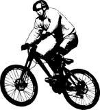 骑自行车的人飞行 库存图片