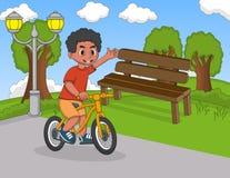 骑自行车的孩子在公园动画片 图库摄影