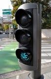 骑自行车绿灯业务量 库存图片