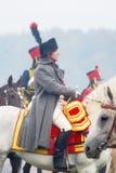 骑马的拿破仑在历史再制定 免版税库存照片