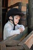 骑马齿轮的男孩 免版税库存照片