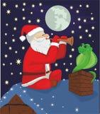 骗子圣诞老人和蛇 免版税库存照片