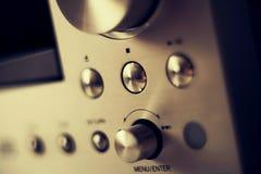 高保真立体声放大器发光的按钮 免版税库存照片