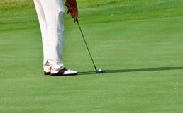 高尔夫球击中 免版税库存图片
