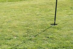 高尔夫球区在一个晴天 免版税库存图片