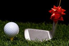 高尔夫球和圣诞节 免版税库存图片