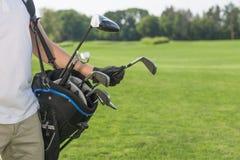 高尔夫球和高尔夫球运动员 免版税库存照片