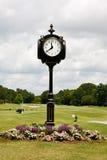 高尔夫球场时钟 免版税库存照片