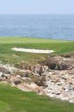 高尔夫球海边 库存图片