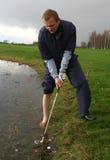 高尔夫球球击 库存图片