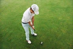 高尔夫球球击 免版税图库摄影