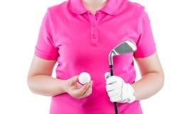 高尔夫球运动员为最后一球和一家高尔夫俱乐部做准备在他的手上 库存图片