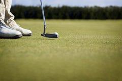 高尔夫球运动员宏指令放置 免版税库存照片