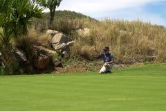 高尔夫球运动员放置 免版税图库摄影