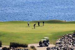 高尔夫球运动员绿色墨西哥海洋 图库摄影