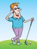 高尔夫球运动员谈话在他的手机 免版税库存图片