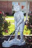 高尔夫球运动员雕象 免版税库存图片