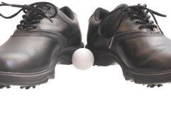 黑高尔夫球鞋子 库存照片