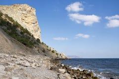 高山,称Eagle,耸立在海湾 库存图片