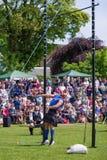 高度学科的重量在苏格兰高地比赛 库存照片
