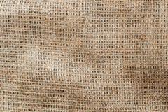 高度粗麻布详细的纹理  与自由空间的麻袋布背景文本输入、商标等等的 图库摄影