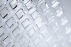 高技术抽象背景 透明塑料或玻璃板料与被删去的孔 激光切口  免版税库存照片