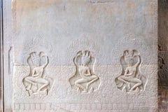 高棉在吴哥窟墙壁上的艺术雕刻  免版税图库摄影