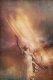 登高的天使 免版税库存照片