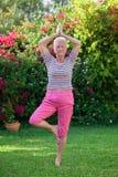 高级女子瑜伽 免版税图库摄影