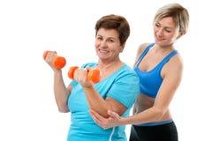 高级妇女在体操方面 免版税库存图片