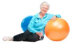 高级妇女在体操方面 免版税库存照片