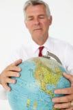 高级生意人藏品地球 免版税库存图片