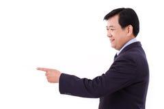高级管理人员,指向空白的中年商人 免版税库存图片
