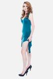 高跟鞋和一件蓝色礼服的性感的女孩 库存照片