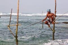高跷渔夫 免版税图库摄影