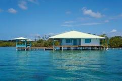 高跷的加勒比房子在水 免版税库存照片