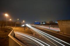 高速公路在与lighttrails的晚上 免版税图库摄影