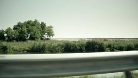 高速公路在欧洲沼泽地 从移动的汽车的看法 股票视频